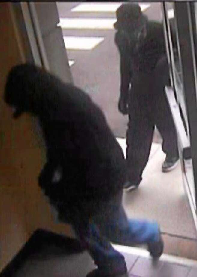 Two suspects seen near Start Community Bank about the time of a June 10 robbery. Photo: Journal Register Co.