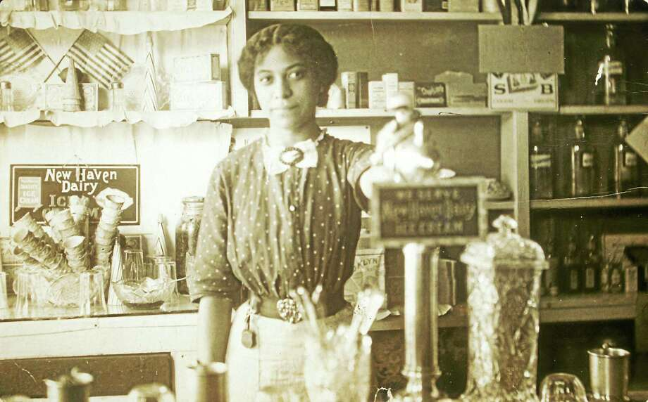Anna Louise James at the soda fountain where she was pharmacist and owner, Old Saybrook, c. 1909-1911. Schlesinger Library, Radcliffe Institute, Harvard University. Photo: Journal Register Co.