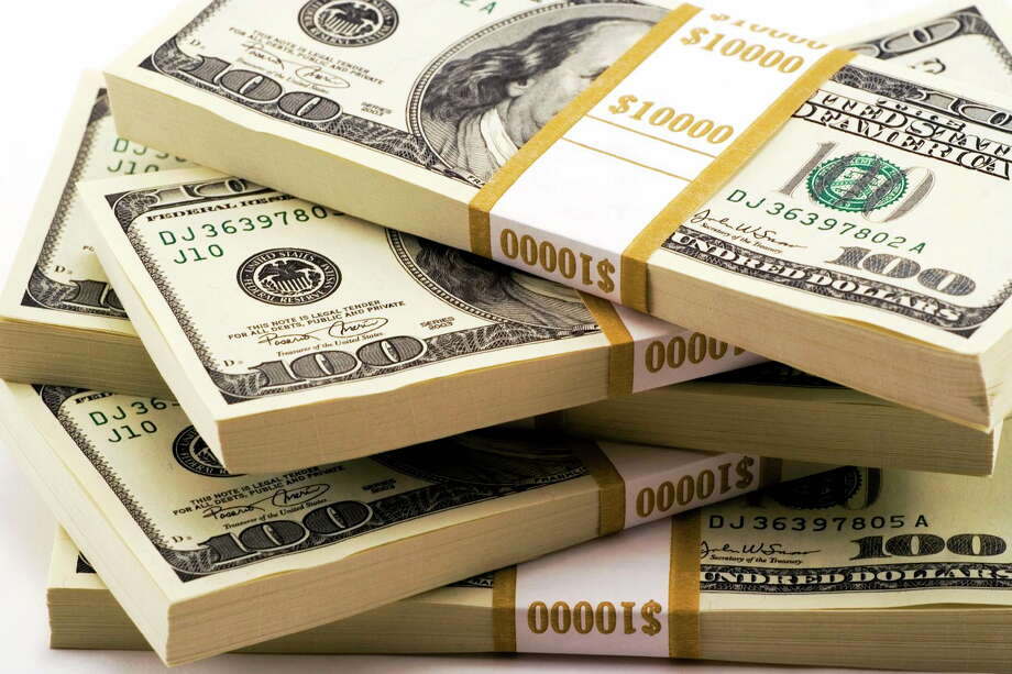 Stack of One Hundred Dollar Bills U.S. Photo: Journal Register Co. / Copyright Bob Ainsworth 2006