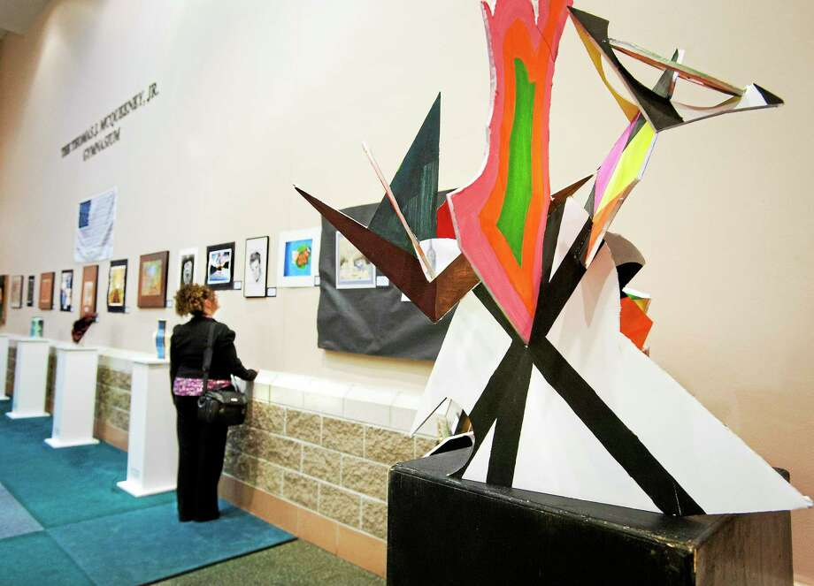 (Melanie Stengel - Register)   Angie Diaz, of Ansonia looks over the artwork displayed at Ansonia High school 5/8. The Valley Celebration of the Atrs event featured work from six area high schools. Photo: Journal Register Co.