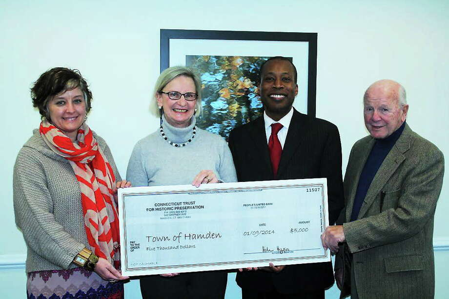 From left, Julie E. Smith, deputy chief administrative officer, Helen Higgins, executive director for CT Trust for Historic Preservation, Mayor Scott D. Jackson and state Sen. Joe Crisco. Contributed photo Photo: Journal Register Co.
