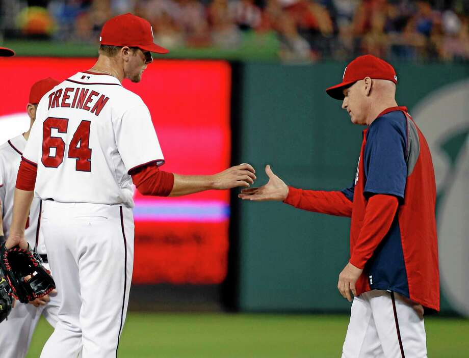 Nationals pitcher Blake Treinen (64) is relieved by manager Matt Williams during the sixth inning against the Los Angeles Dodgers on Tuesday in Washington. Photo: Alex Brandon — The Associated Press   / AP