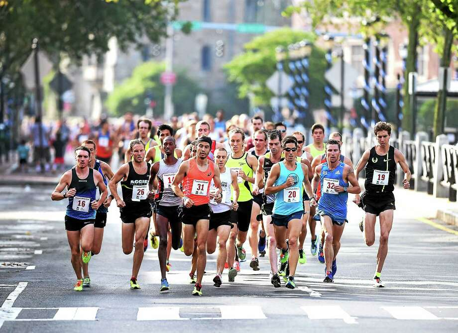 (Arnold Gold-New Haven Register)  Runners make their way up Broadway at the start of the 37th Annual Faxon Law New Haven Road Race on 9/1/2014. Photo: Journal Register Co.