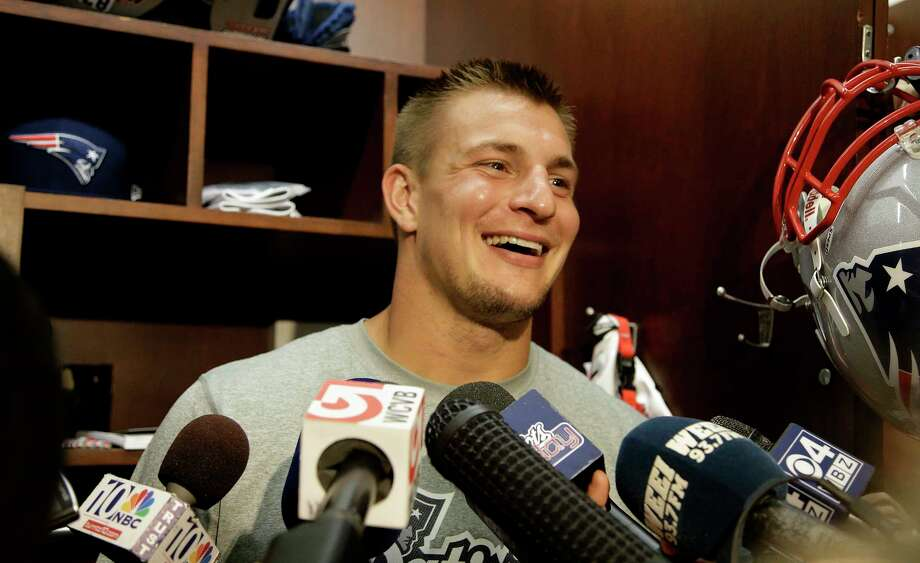New England tight end Rob Gronkowski stood in front of his Gillette Stadium locker on Monday and announced he will be playing in the Patriots' opener at Miami this Sunday. Photo: Stephan Savoia — The Associated Press   / AP