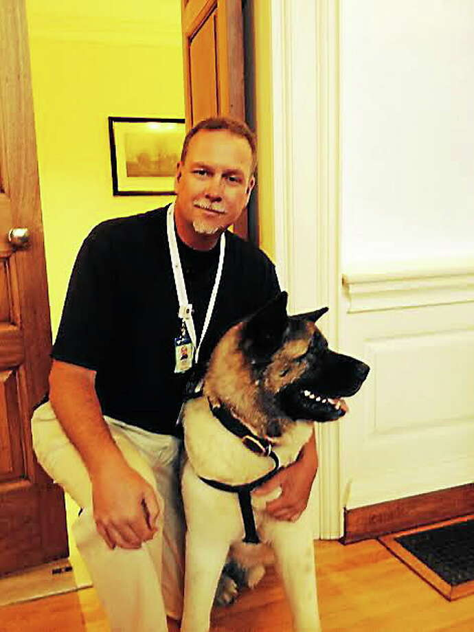 Brad Cole and his therapy dog, Spartacus. Photo: Pam McLoughlin — New Haven Register