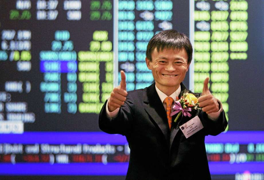 FILE - In this Nov. 6, 2007 file photo, Jack Ma, founder and CEO of Alibaba, celebrates at his company listing ceremony at the Hong Kong Stock Exchange. The mammoth IPO planned by e-commerce giant Alibaba Group highlights founder Maís improbable rise to Chinaís entrepreneur-in-chief.  (AP Photo/Kin Cheung, File) Photo: AP / AP