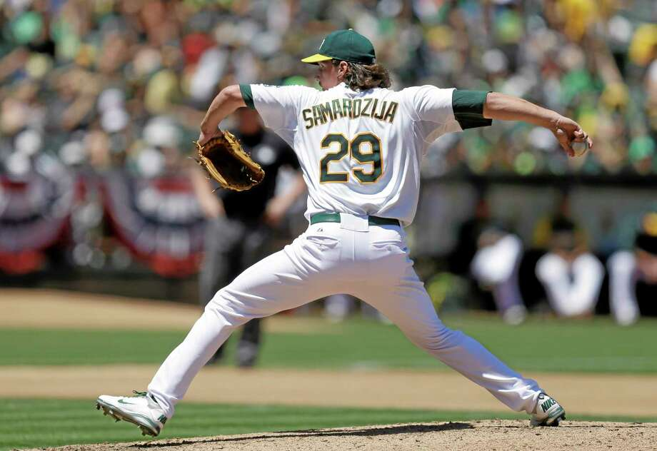 The Athletics' Jeff Samardzija works against the Blue Jays in the fourth inning Sunday. Photo: Ben Margot — The Associated Press   / AP