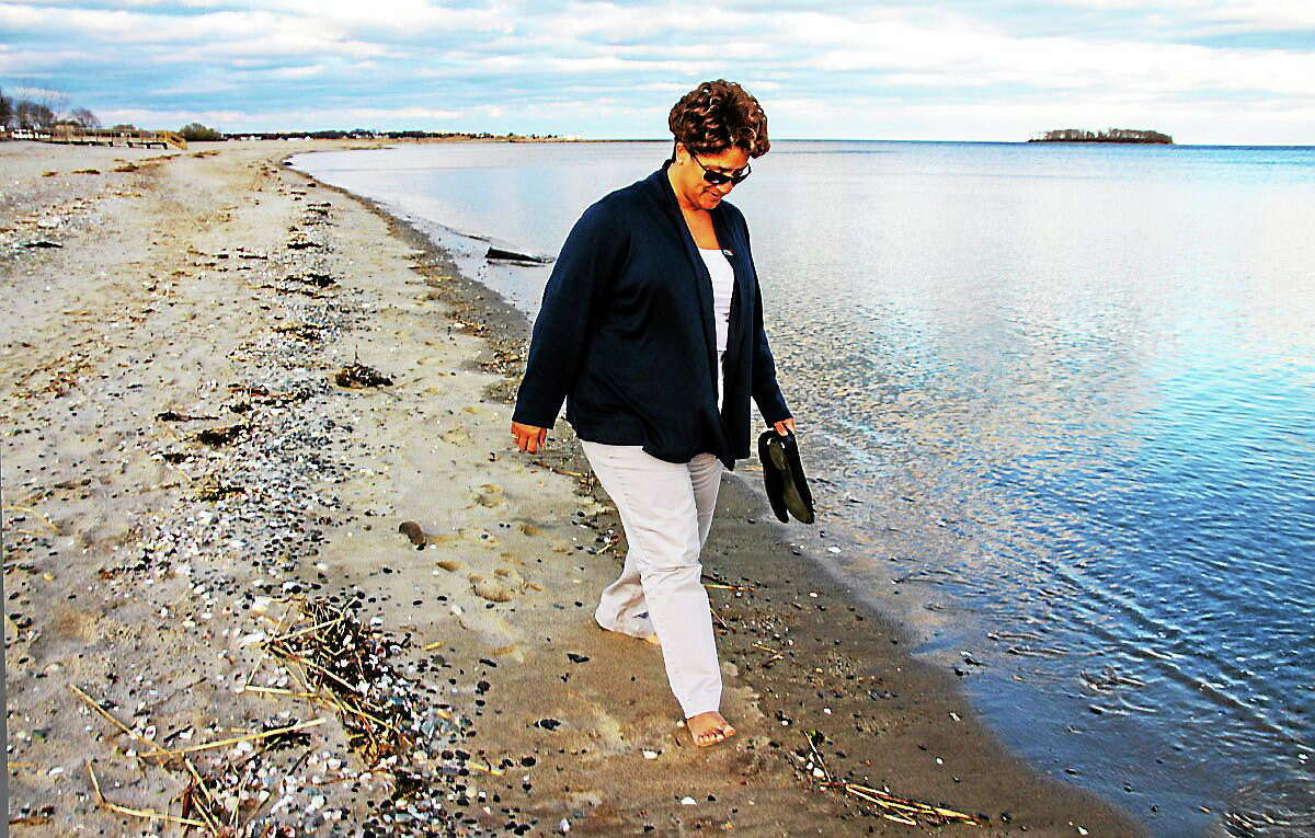 Iraq war veteran Eunice Ramirez finds comfort in her walks at Walnut Beach in Milford.