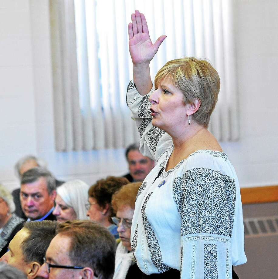 (Peter Casolino-New Haven Register)    Lesia Melnyk of Avon asks questions during a meeting at the St. Michael Parish Ukrainian (New Haven) church hall Sunday concerning the events in the Ukraine. DeLauro visited the church to answer questions about the government's  response to the takeover of Crimea by Russian forces. Photo: Journal Register Co.