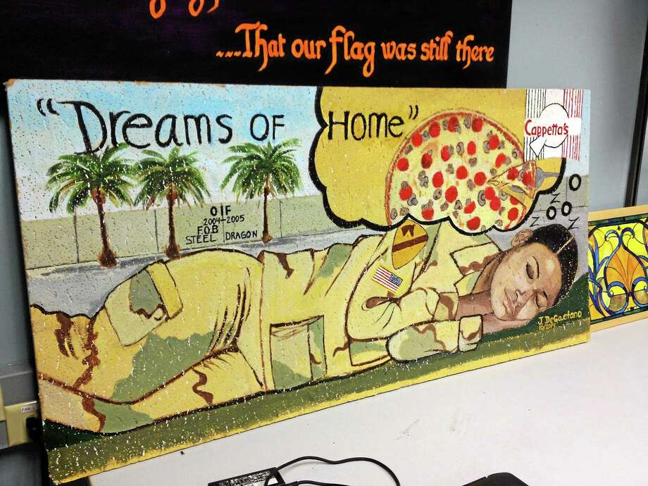 This ceiling tile by Iraq war veteran Jennifer DeGaetano will be on display at Cappetta's in West Haven. She said art helps her healing process. Photo: (Kristin Stoller — New Haven Register)