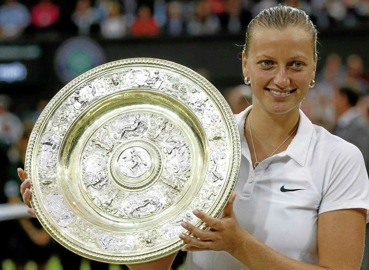 Petra Kvitova holds the trophy after winning the women's final against Eugenie Bouchard Saturday at the All England Lawn Tennis Championships in Wimbledon, London.