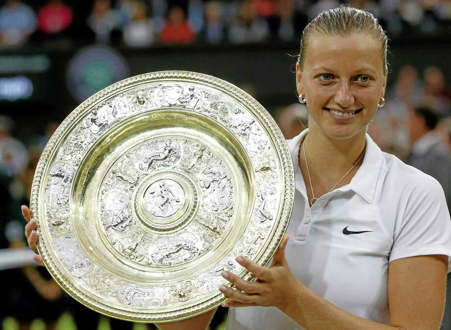 Petra Kvitova holds the trophy after winning the women's final against Eugenie Bouchard Saturday at the All England Lawn Tennis Championships in Wimbledon, London. Photo: Sang Tan — The Associated Press   / AP