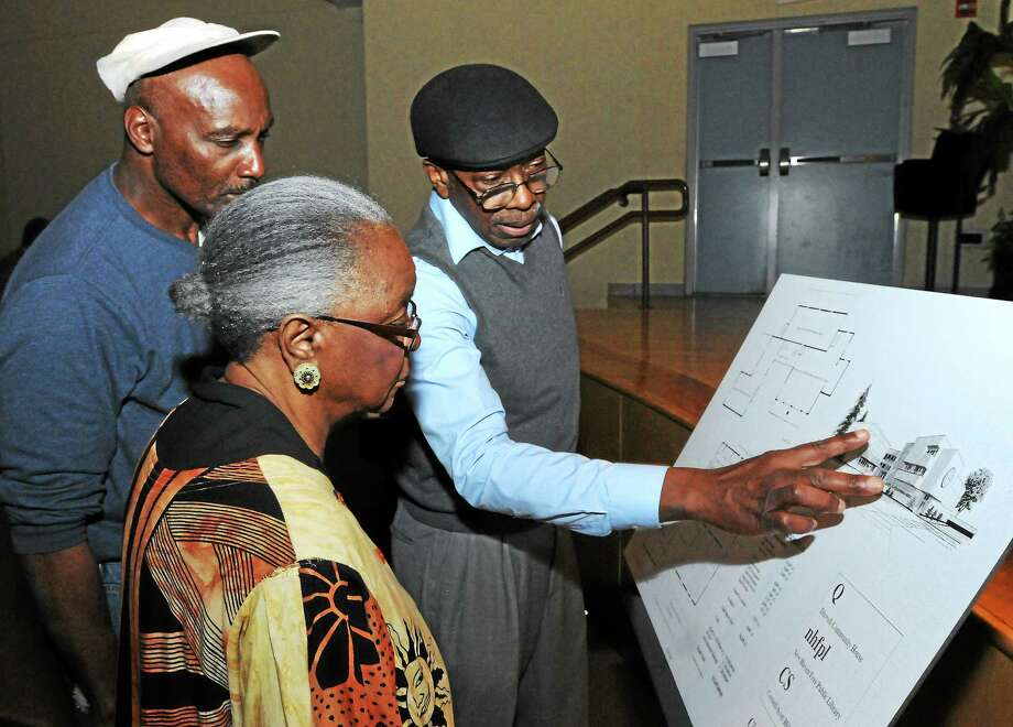Ann Robinson, Jerome Perkins and Jerry Poole, all of New Haven, look at the engineering drawing of a renovated Q House at a hearing Wednesday at Wexler-Grant School in New Haven. Photo: Mara Lavitt — New Haven Register    / Mara Lavitt