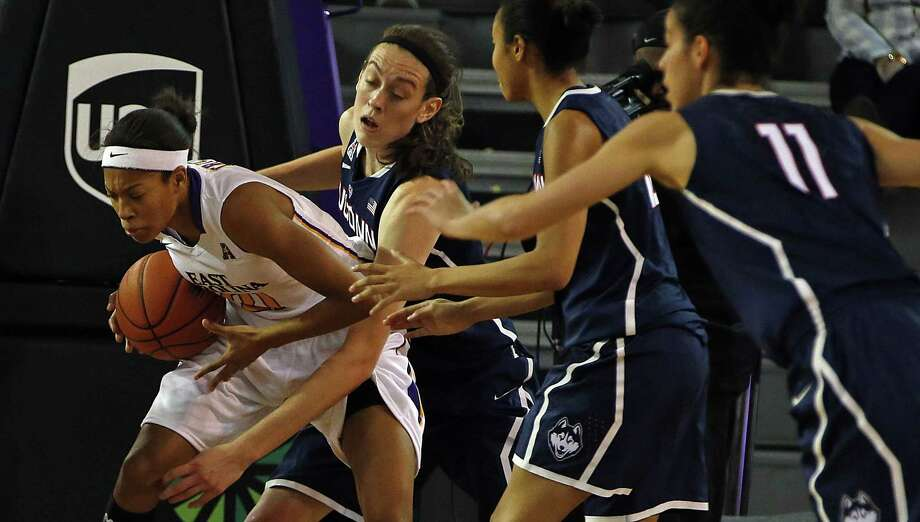 East Carolina's Abria Trice, left, battles with UConn's Breanna Stewart during the second half of the Huskies' 89-38 win on Wednesday in Greenville, N.C. Photo: Karl B. DeBlaker — The Associated Press   / FR7226 AP