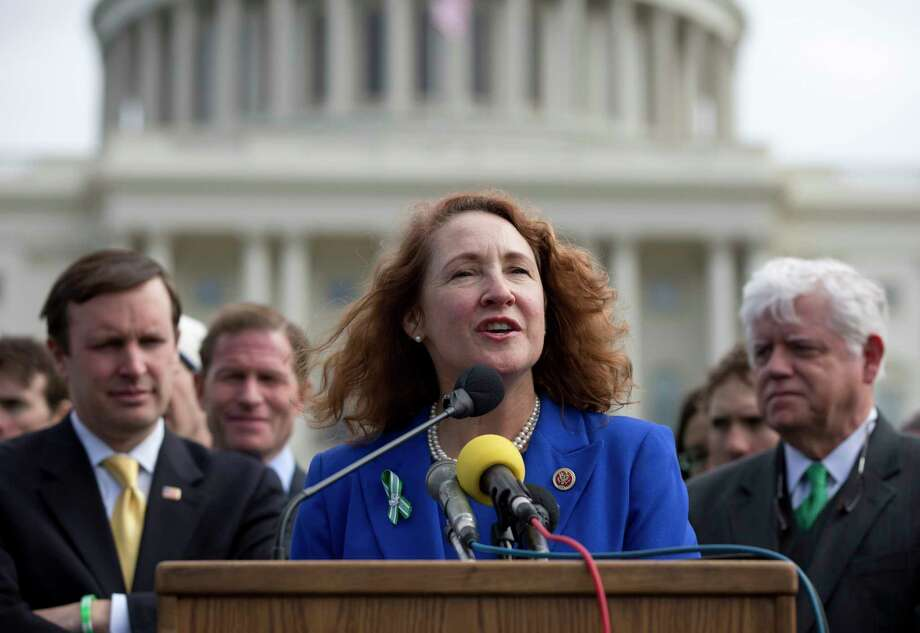 FILE - In this March 12, 2013 file photo, Rep. Elizabeth Esty, D-Conn., center, speaks during a news conference on Capitol Hill in Washington.  Connecticut's 5th congressional district election is once again expected to be one of the most expensive in the nation. Already, pro-Democrat outside groups have reserved $2.3 million in TV ad time to benefit  Esty, while her wealthy Republican opponent, Mark Greenberg, has already loaned his campaign more than $1 million. (AP Photo/Carolyn Kaster) Photo: AP / AP