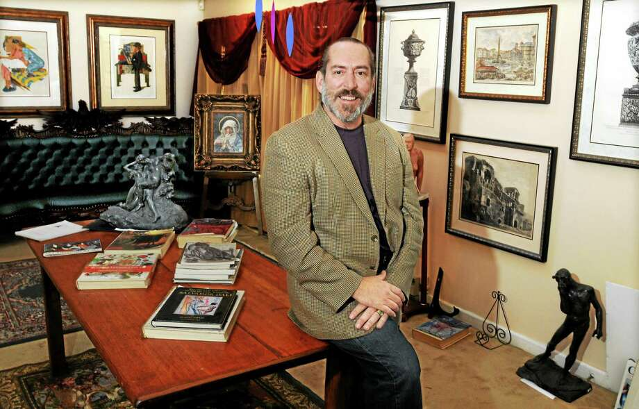 MARA LAVITT — NEW HAVEN REGISTER  This November 2010 file photo shows David Crespo, then the owner of Brandon Gallery in Madison, with some of the art he sold including signed, limited edition Norman Rockwell prints behind him at left. Photo: Journal Register Co.
