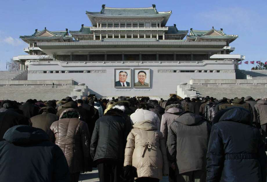FILE - In this Dec. 17, 2014, file photo, North Koreans gather at Kim Il Sung Square in Pyongyang, most bowing toward portraits of their late leaders as an act of respect, to mark the third anniversary of the death of Kim Jong Il. Photo: (Jon Chol Jin — The Associated Press) / AP