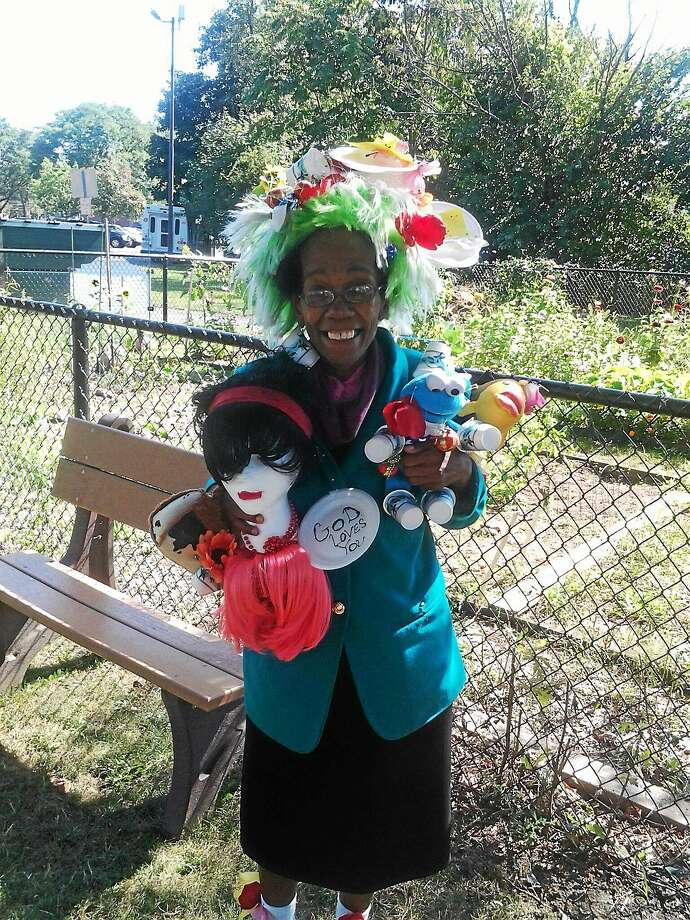 Betty Boyd, of Hamden poses with her handmade clown accessories Photo: Ebony Walmsley/New Haven Register