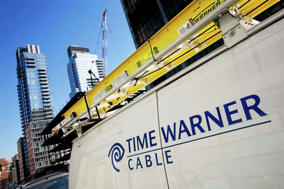 FILE - In this Feb. 2, 2009 file photo, a Time Warner Cable truck is parked in New York.  Cable TV operator Charter Communications said Monday, Jan. 13, 2014, it wants to buy the much larger Time Warner Cable in a cash-and-stock deal that could be worth up to $38 billion. (AP Photo/Mark Lennihan, file) Photo: AP / AP