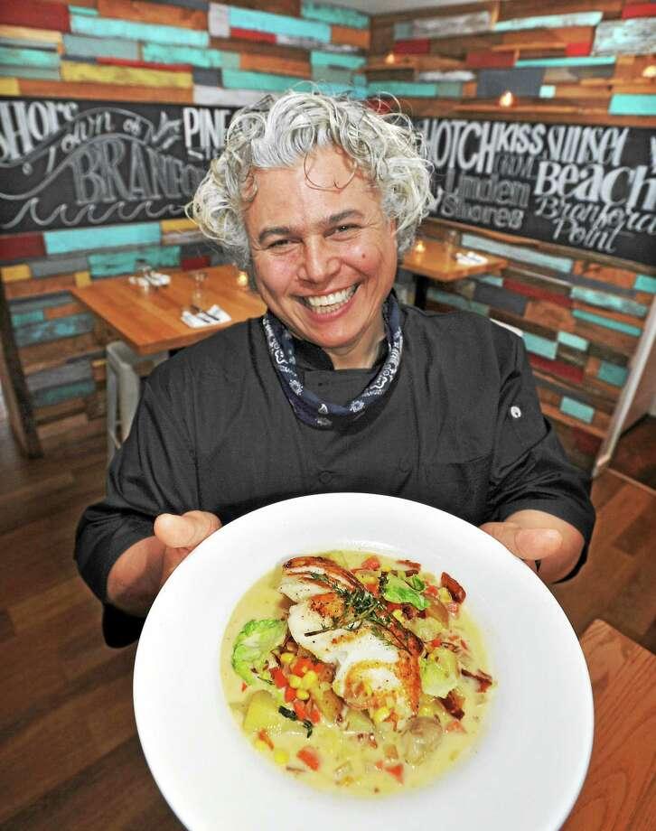 "At Beach & Barn Bar and Bistro in Branford, owner and chef Arturo Franco-Camacho with his Atlantic Cod ""Chowda"" Style. Photo: Mara Lavitt — New Haven Register Photos    / Mara Lavitt"