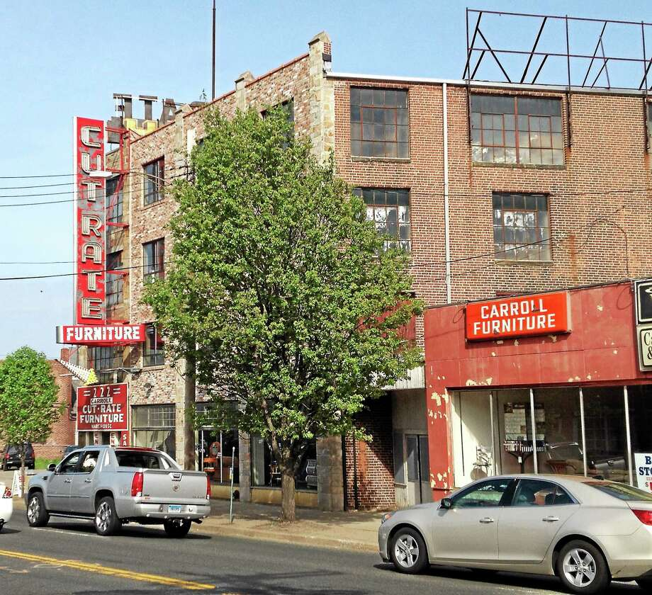 Former Carroll Cut-Rate Furniture building on Route 1 in Allingtown. Mark Zaretsky - New Haven Register Photo: Journal Register Co.