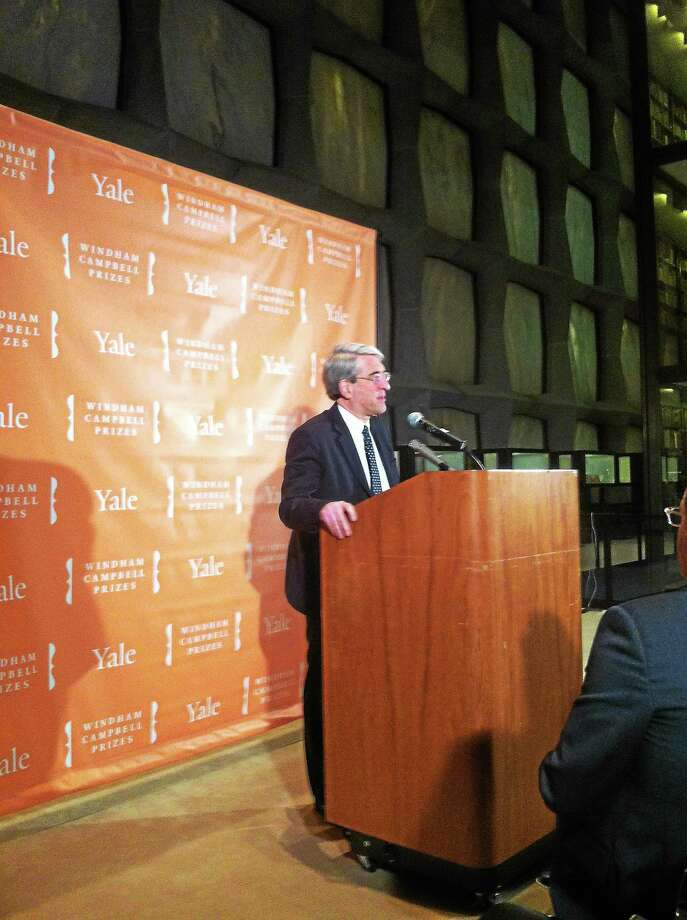 Yale University President Peter Salovey announces the winners of the 2014 Windham Campbell Prizes Friday in New Haven. Photo: Jim Shelton — New Haven Register
