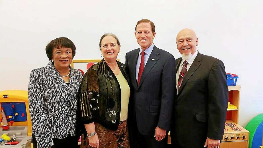 At the 'r kids Family Center in New Haven Friday, l to r, New Haven Mayor Toni Harp, 'r kids Executive Director Randi Rubin Rodriguez, U.S. Sen. Richard Blumenthal, 'r kids co-founder Sergio Rodriguez. Photo: (Evan Lips — New Haven Register)