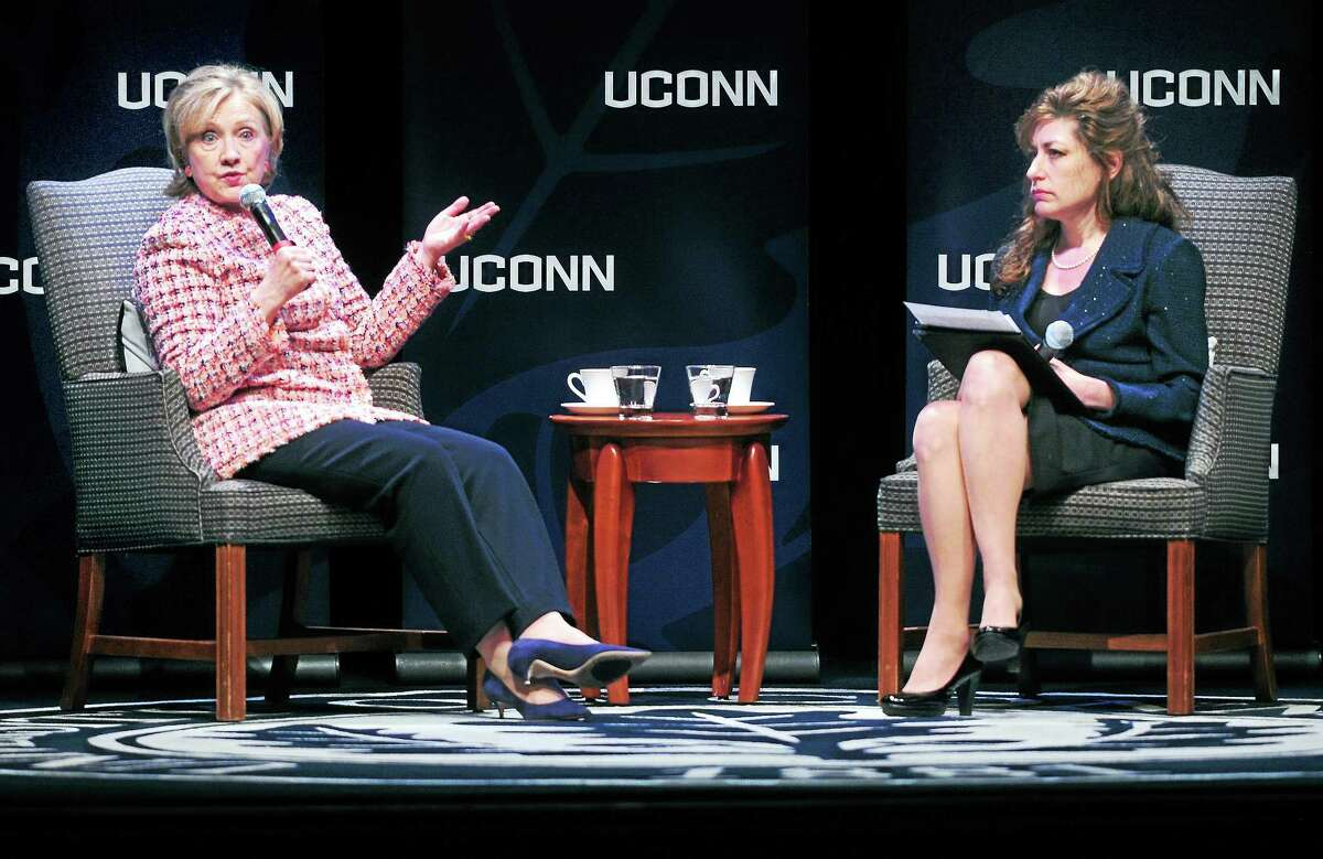 Former Secretary of State Hillary Clinton, left, answers questions read by University of Connecticut president Susan Herbst at the Edmund Fusco Contemporary Issues Forum at UCONN on April 23, 2014.