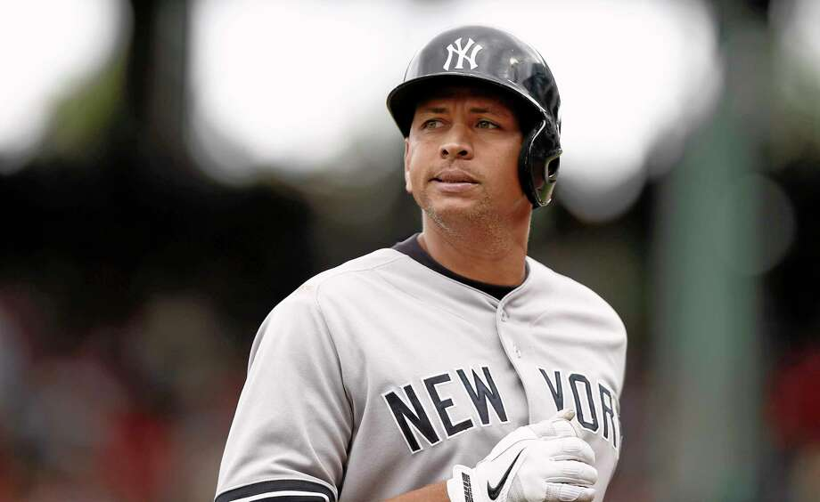 FILE - In this Sept. 14, 2013 file photo, New York Yankees' Alex Rodriguez heads to the dugout during the Yankees 5-1 loss to the Boston Red Sox  in a baseball game at Fenway Park in Boston.  Rodriguez's drug suspension has been cut to 162 games from 211 by arbitrator Fredric Horowitz, a decision sidelining the New York Yankees third baseman the entire 2014 season.  (AP Photo/Winslow Townson) Photo: AP / FR170221 AP