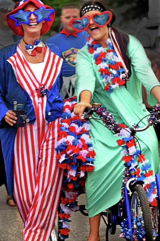 Heidi Staniszewski, left, and Kasey Gagstetter take part in the annual Bayview Beach neighborhood 4th of July Parade Friday. Photo: (Melanie Stengel — NEW HAVEN Register)