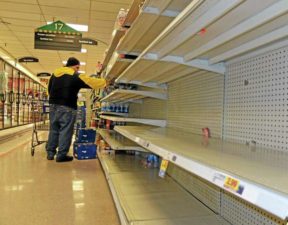 Jim Cole of Exeter, N.H., got the last few bottles of water at the Kroger in South Charleston W.Va. following a chemical spill on the Elk River that compromised the public water supply to eight counties of Thursday, Jan. 9, 2014. (AP Photo/Tyler Evert) Photo: AP / FR170609 AP