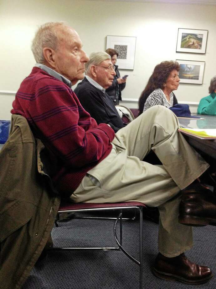 Norman Silverman, 88, left, and Ed Abrams, 93, listen to discussion on health insurance Friday at the Hamden Government Center. Photo: Mary E. O'Leary — New Haven Register