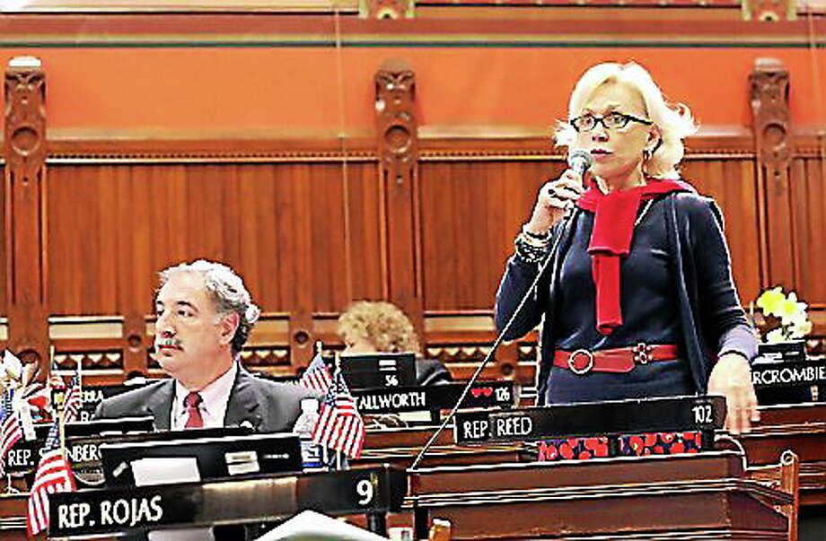 Rep. Jonathan Steinberg, left, listens as Rep. Lonnie Reed debates the bill. Photo: Christine Stuart — CT News Junkie