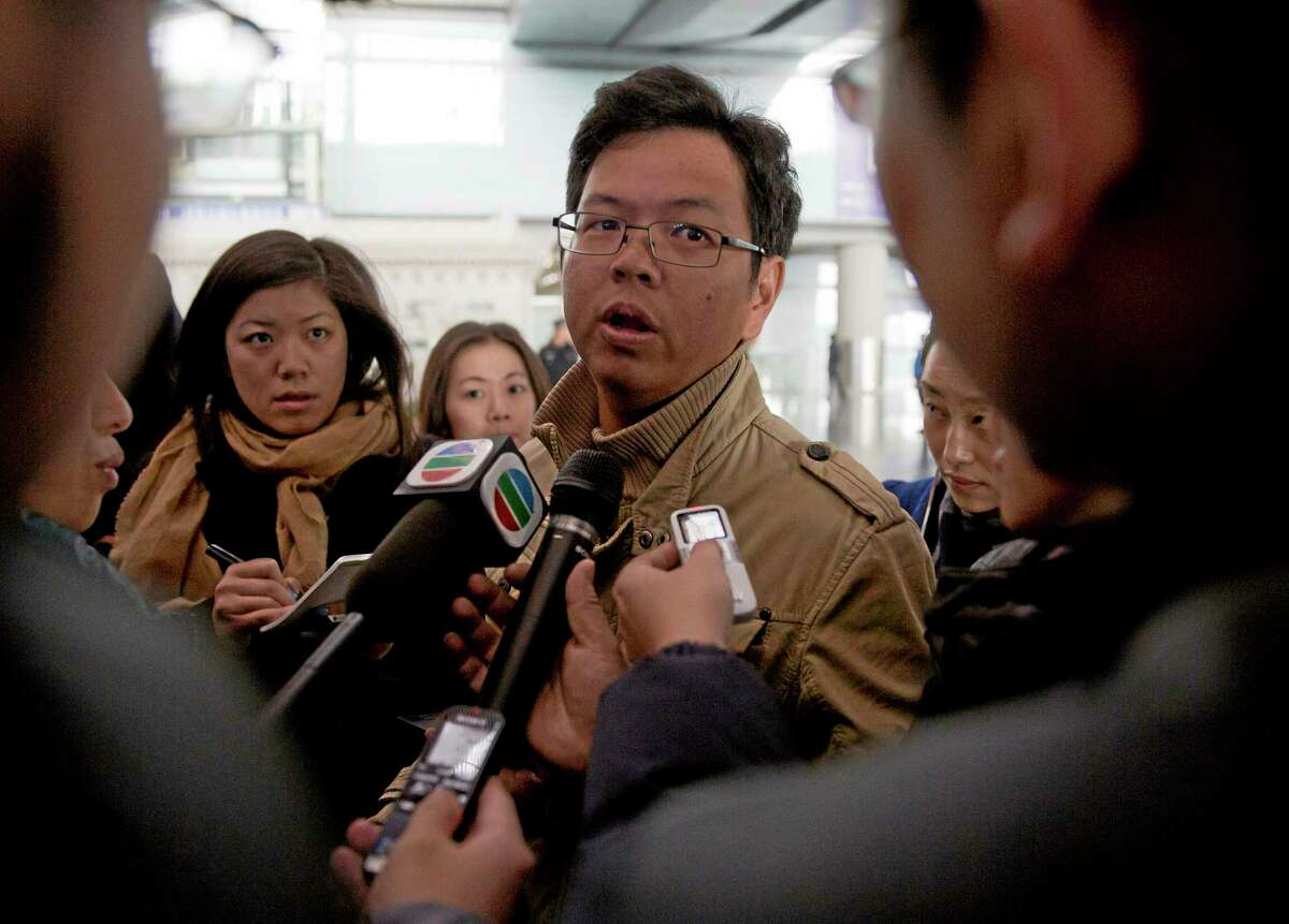 A Malaysian man who says he has relatives on board the missing Malaysian Airlines plane talks to journalists at Beijing's International Airport Beijing, China, Saturday.