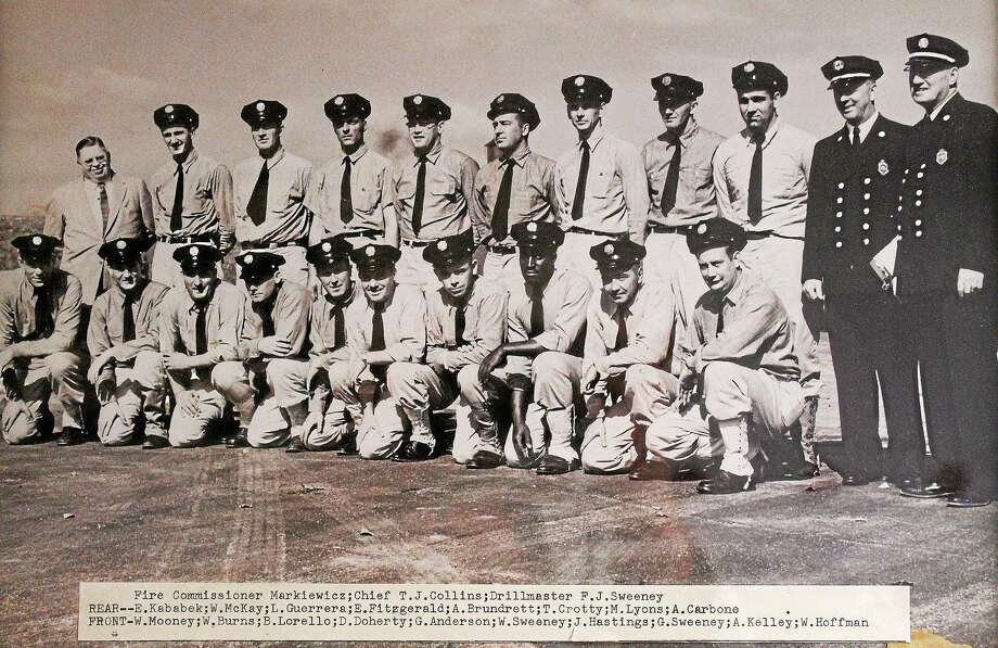 George Sweeney, the first black firefighter to actively serve in a New Haven firehouse, died Dec. 5. This photo from the fire academy shows his 1957 graduating class. Photo: CONTRIBUTED PHOTO