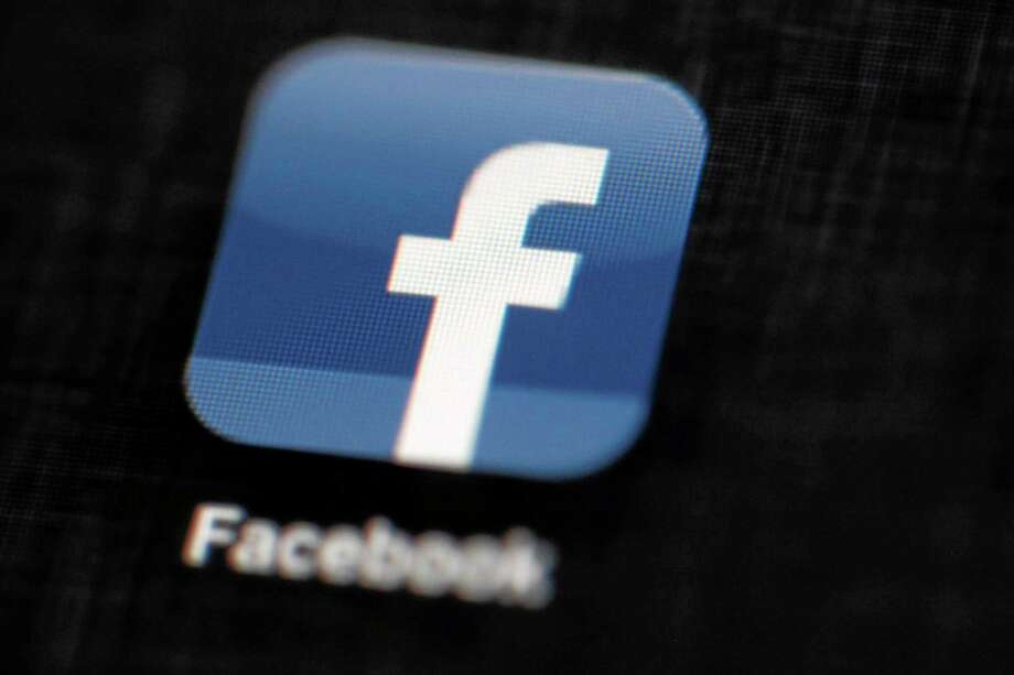 FILE - In this May 16, 2012 file photo, the Facebook logo is displayed on an iPad in Philadelphia. Under pressure from gun control advocates, Facebook agreed Wednesday, March 5, 2014,  to delete posts from users selling illegal guns or offering weapons for sale without background checks. (AP Photo/Matt Rourke, Facebook) Photo: AP / AP
