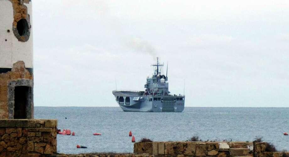 The Italian Navy ship San Giorgio leaves the Brindisi harbor, Italy, on Dec. 28, 2014. Photo: AP Photo/Max Frigione   / AP