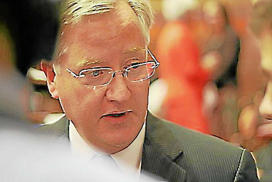 By Christine Stuart File Photo ¬ House Speaker Brendan Sharkey steps off the dais and is surrounded by the media in the final days of session Photo: Journal Register Co.