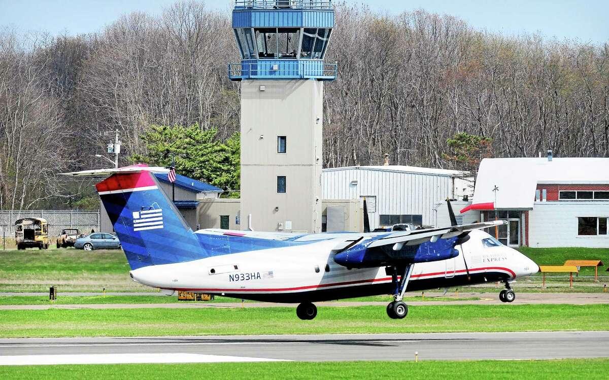 A US Airways flight lands at Tweed New Haven Regional Airport last week.