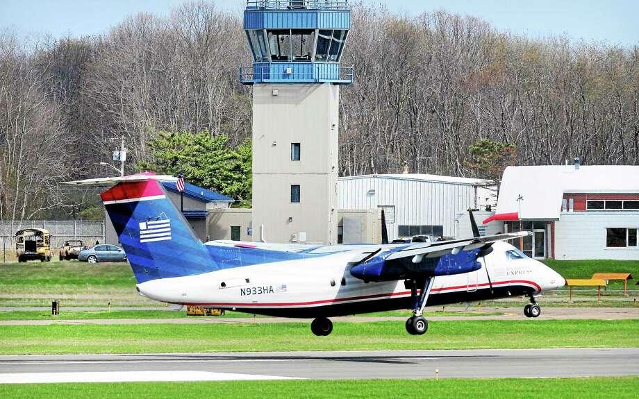 A US Airways flight lands at Tweed New Haven Regional Airport last week. Photo: (Arnold Gold-New Haven Register)