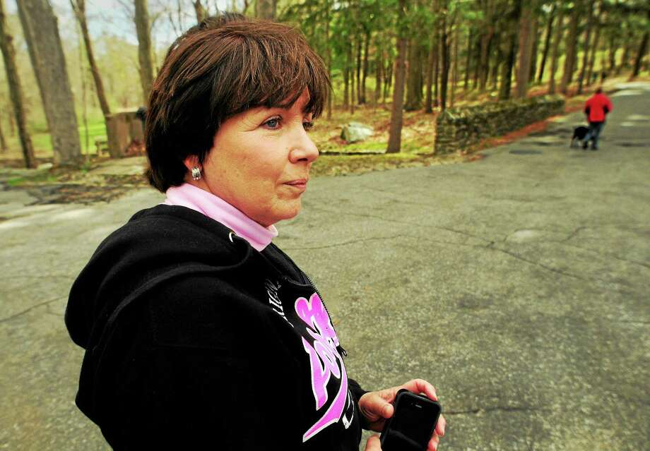 (Peter Hvizdak - New Haven Register)  Janice Smolinski of Cheshire searches a Valley woods Sunday following up on a tip received by her and her husband, Bill Smolinski Sr., about the location of their missing son, Bill Smolinski Jr. Two volunteer certified search and rescue cadaver dog teams were involved in the search. Photo: New Haven Register / ©Peter Hvizdak /  New Haven Register