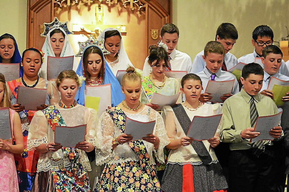 """St. Mary School, Milford, students celebrate May Crowning, a """"crowning"""" in song, Scripture, dance and pageantry led by graduating eighth-graders. Photo: CREDIT HERE"""