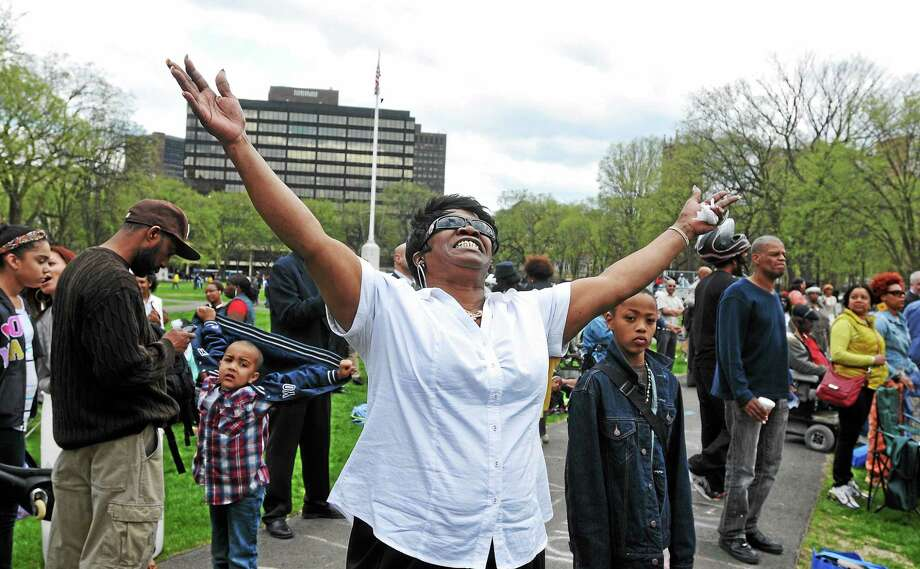 Betty Williams of New Haven prays on the Green during the prayer service. The event organized by city pastors were helping to help heal the community and end the violence through prayer and love. Photo: (Peter Casolino-New Haven Register)