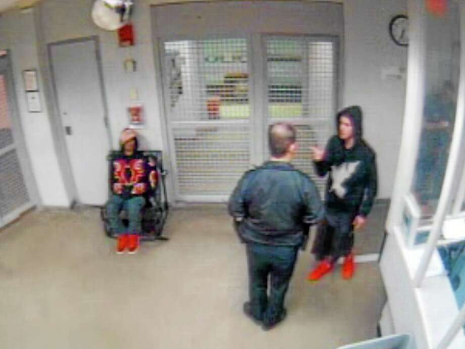 In this Jan. 23, 2014 video frame grab released by the Miami Beach Police Department, shows singer Justin Bieber, right, as he gestures to a police officer while under arrest at the Miami Beach police in Miami Beach, Fla. The Miami-Dade county prosecutors released about 10 hours of video, Wednesday, Feb. 26, 2014. Bieber pleaded not guilty to driving under the influence, resisting arrest and driving with an invalid license. (AP Photo/Miami Beach Police Dept. HO) Photo: AP / Miami Beach Police Dept.
