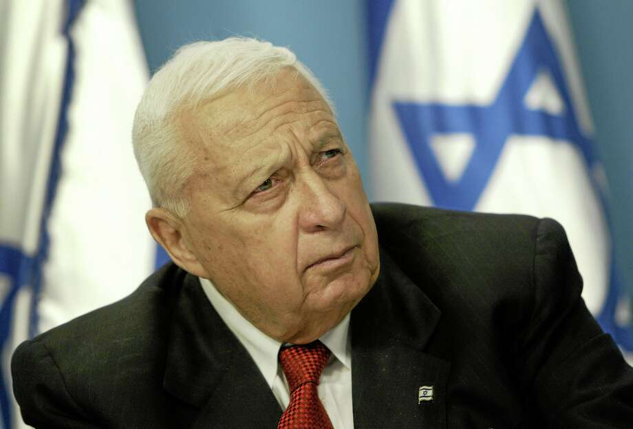 FILE - In this Sunday May 16, 2004 file photo, Israeli Prime Minister Ariel Sharon pauses during a news conference in his Jerusalem office regarding education reform. Sharon, the hard-charging Israeli general and prime minister who was admired and hated for his battlefield exploits and ambitions to reshape the Middle East, died Saturday, Jan. 11, 2014. The 85-year-old Sharon had been in a coma since a debilitating stroke eight years ago. (AP Photo/Oded Balilty, File) Photo: AP / AP