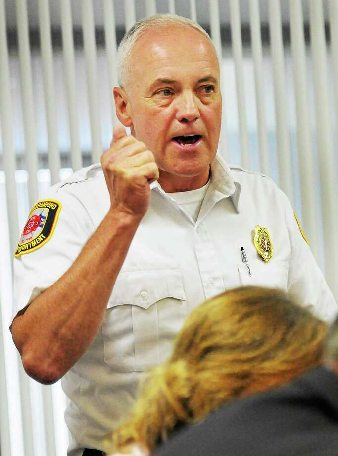 North Branford Fire Chief William H. Seward III express his dissatisfaction with CMED and its communications equipment and database information as he speaks during a CMED Board of Directors meeting May 5 at the South Central Regional Council of Governments offices in North Haven. Photo: Peter Hvizdak — New Haven Register FILE PHOTO   / ©Peter Hvizdak /  New Haven Register