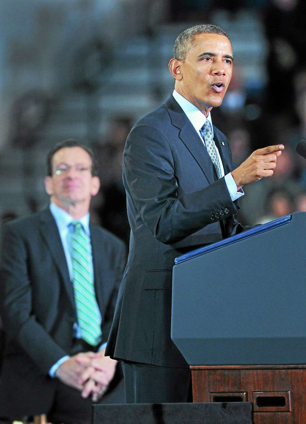 Arnold Gold - New Haven Register President Barack Obama speaks about raising the minimum wage at Central Connecticut State University in New Britain Wednesday. At left is Gov. Dannel P. Malloy.