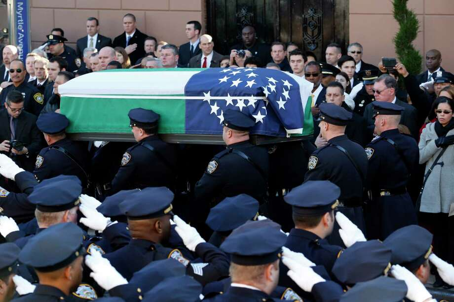 Pallbearers carry the casket of New York City police officer Rafael Ramos following funeral services at Christ Tabernacle Church, in the Glendale section of Queens, Saturday, Dec. 27, 2014, in New York. Ramos and his partner, officer Wenjian Liu, were killed Dec. 20 as they sat in their patrol car on a Brooklyn street. The shooter, Ismaaiyl Brinsley, later killed himself. Photo: (Julio Cortez — The Associated Press) / AP