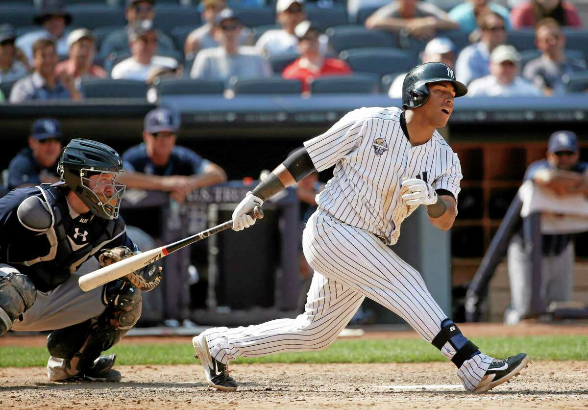 The Yankees' Yangervis Solarte reacts to striking out with Brian Roberts at second base in the eighth inning of Wednesday's 6-3 loss to the Tampa Bay Rays at Yankee Stadium in New York.