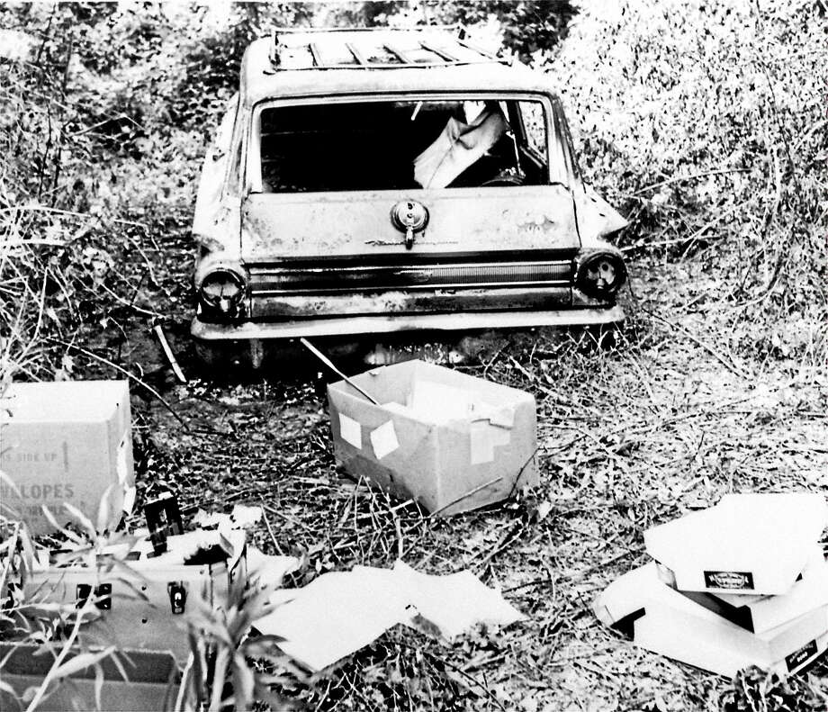 This June 24, 1964 photo shows the burned station wagon of three missing civil rights workers, Michael Schwerner, Andrew Goodman, and James Chaney, in a swampy area near Philadelphia, Miss. The bodies of the men were found later in an earthen dam. Photo: AP Photo/Jack Thornell, File   / AP